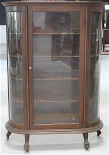 LATE VICTORIAN OAK CURVED GLASS CHINA CLOSET,