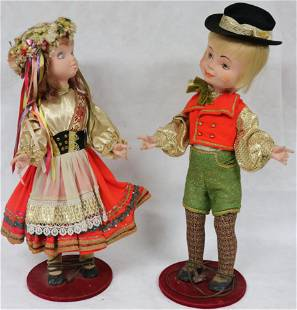 """TWO MID 20TH C. AUTOMATONS, MALE & FEMALE, 34"""" -"""