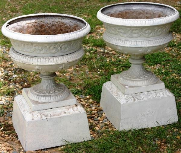 10: 2 CAST IRON URNS, BY KRAMER BOOTHENS