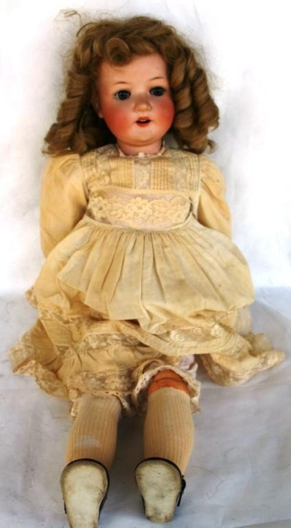 7: BISQUE HEAD DOLL, JOINTED COMPOSITION BODY,