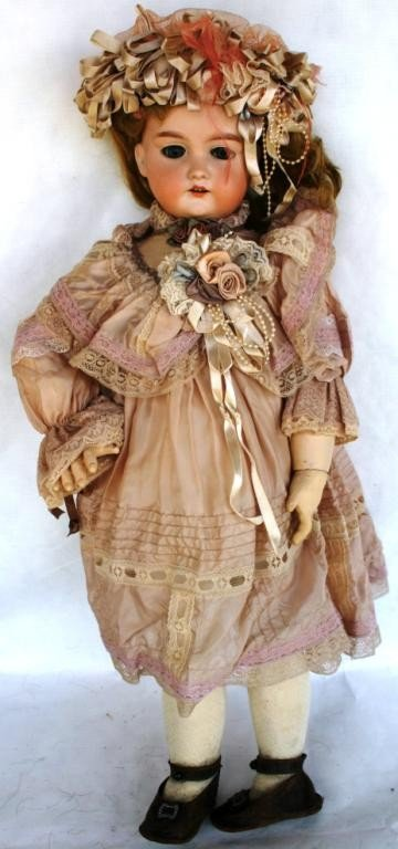 9: PORCELAIN BISQUE HEAD DOLL, JOINTED