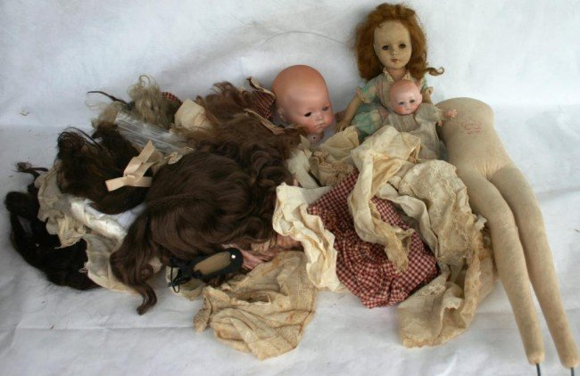 21: LARGE LOT OF MISC. DOLL CLOTHES, WIGS,