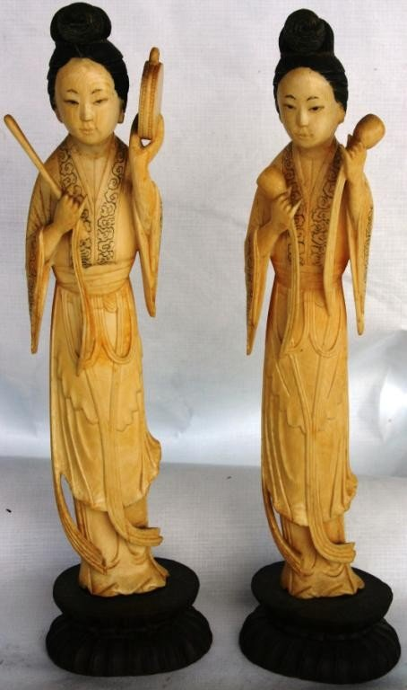 156: TWO ORIENTAL CARVED IVORY FEMALE FIGURES