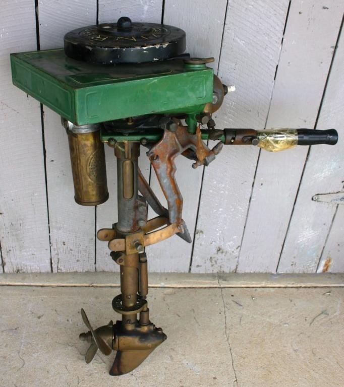 12: INTERESTING OLD OUTBOARD MOTOR WITH
