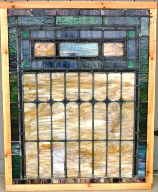 11: LEADED MULTI COLORED SLAG GLASS WINDOW