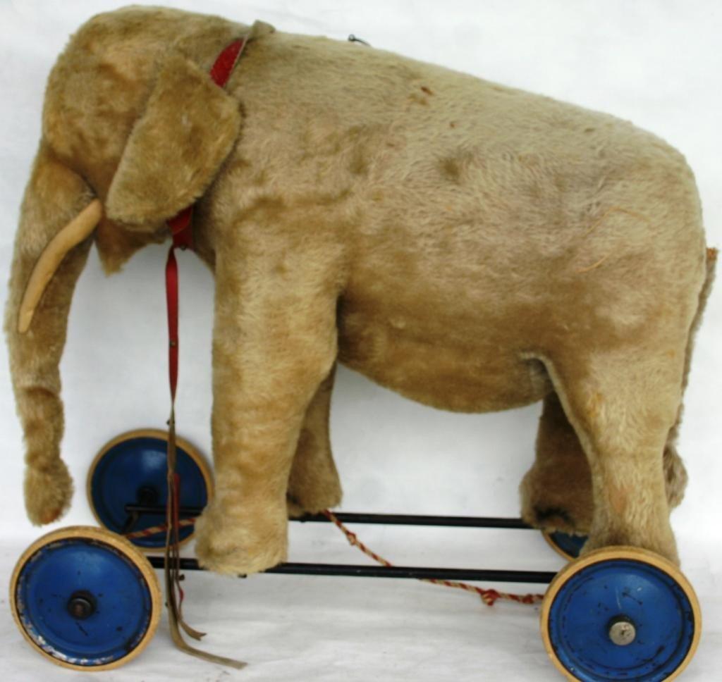14: PLUSH ELEPHANT RIDING TOY, WITH NOISE MAKER