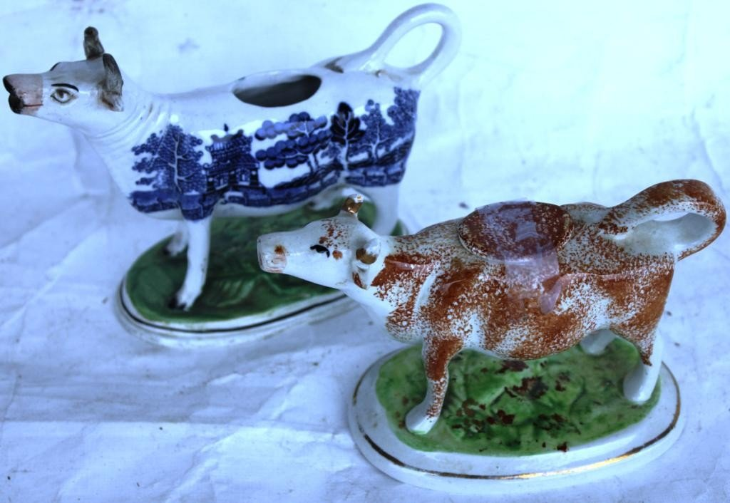 24: TWO 19TH C. STAFFORDSHIRE COW CREAMERS,