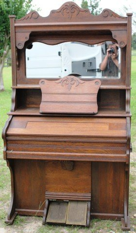 10: VICTORIAN OAK ORGAN WITH SHAPED BEVELED MIRROR
