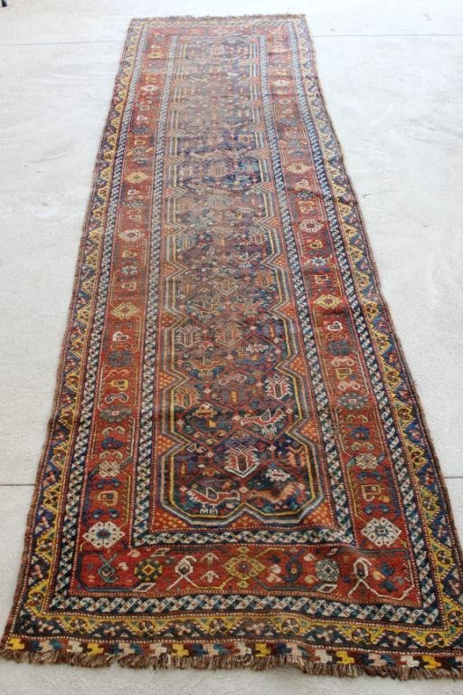 "2' 2"" X 11' 9"" CAUCASIAN RUNNER WITH BIRD FIGURES"