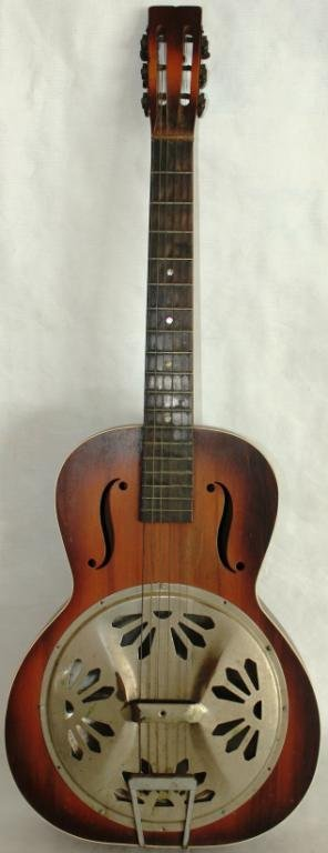 UNUSUAL GUITAR WITH METAL RESONATOR PANEL,