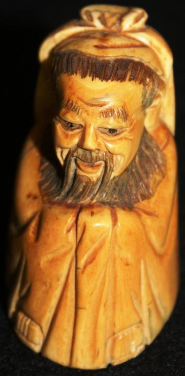 CARVED IVORY FIGURE OF A CLOAKED MAN,