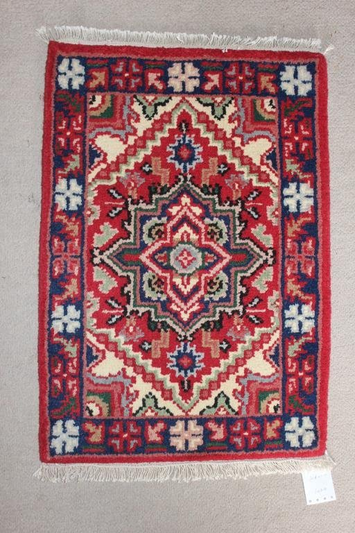 "RUG #748 2'4"" X 1' 10"" HERIZ, RED BORDER"