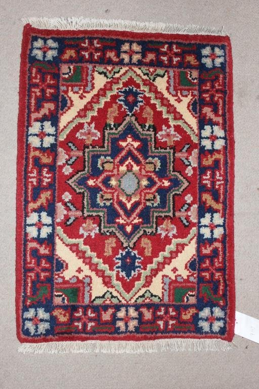 "RUG #749 2'4"" X 1' 10"" HERIZ, RED BORDER"