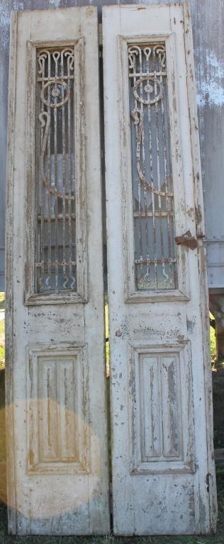 2 SIMILAR WHITE DOORS WITH IRON GRATES
