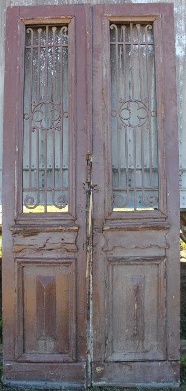 PAIR TALL BROWN DOUBLE DOORS WITH RAISED