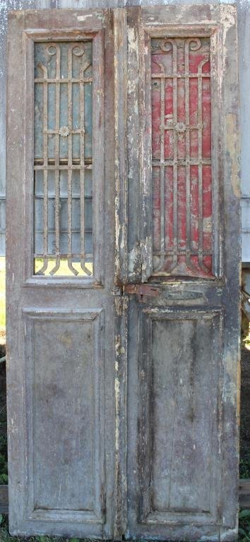 PAIR BROWN DOUBLE DOORS WITH IRON GRATES