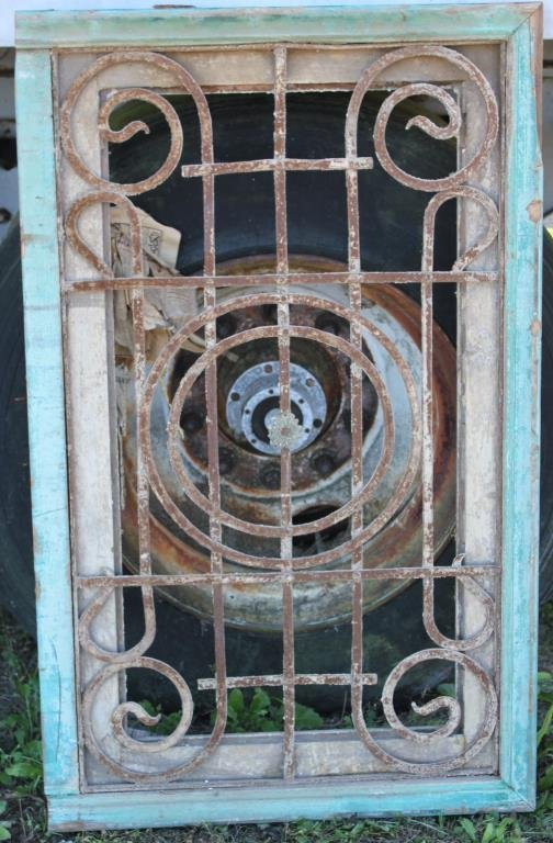 WINDOW FRAME WITH METAL GRATE