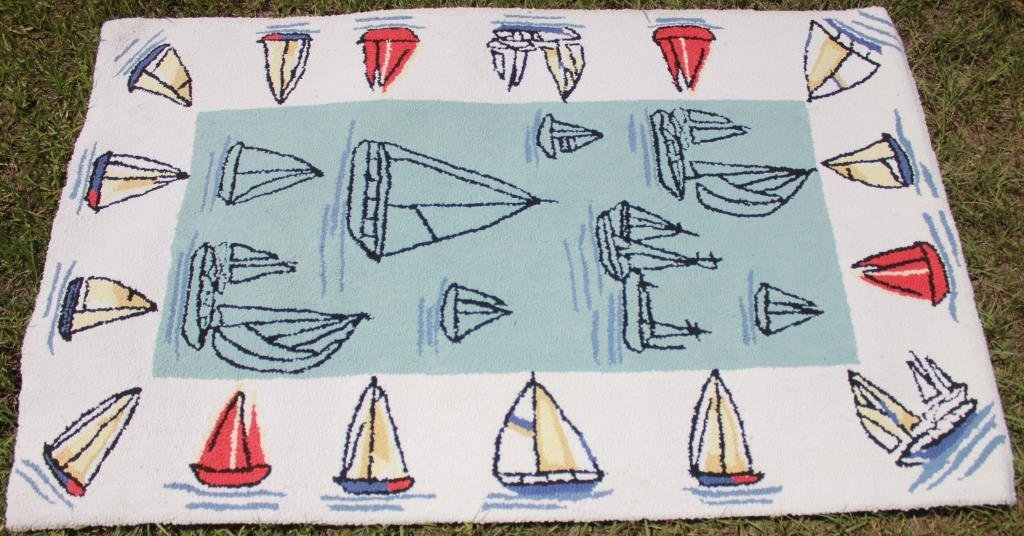 MACHINE MADE RUG WITH SAIL BOATS,