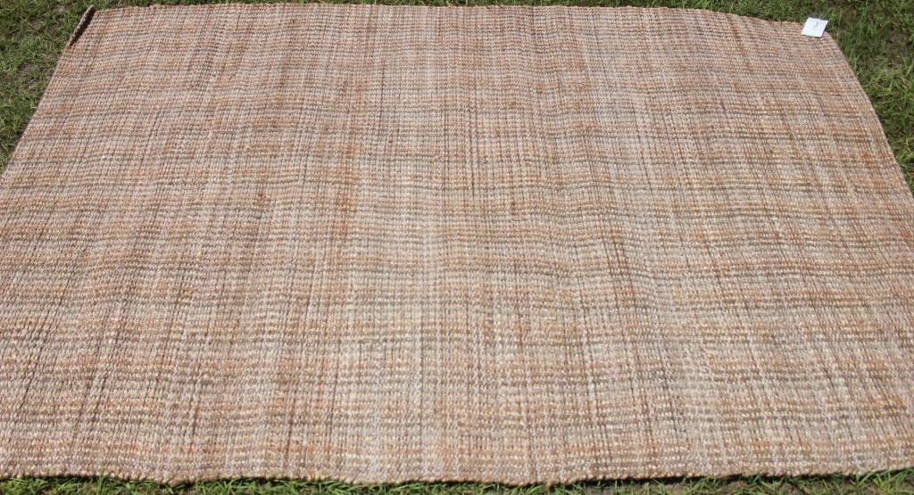 TUFTED OATMEAL COLORED RUG,