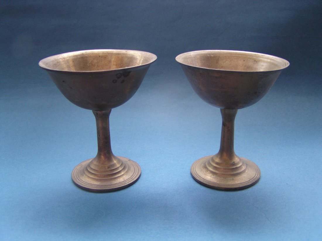 A  PAIR OF BRONZE CUP
