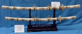ANTIQUE CHINESE OX BONE SWORDS SET ON WOOD STAND