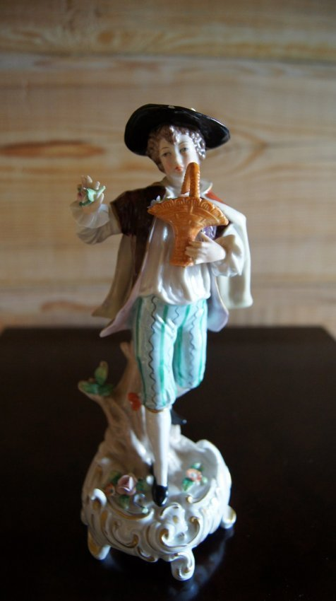 OLD EUROPEAN PORCELAIN FIGURINE - BOY WITH FLOWERS