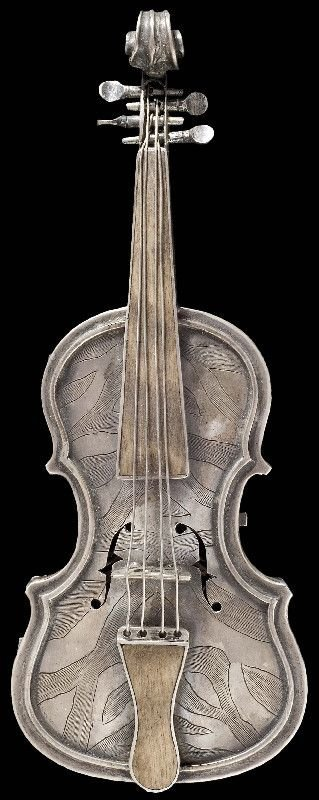 Faberge - A silver miniature violin with clock