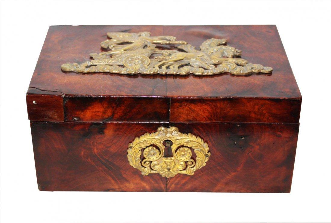 Empire 19th c Flame Mahogany box with Bronze Motiff