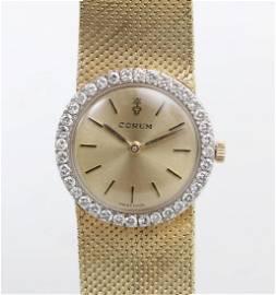 18k gold and diamond Corum watch