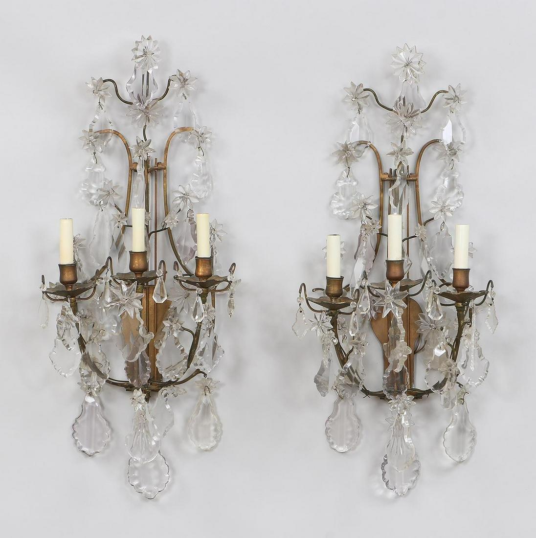 Pair of three light gilt bronze crystal sconces