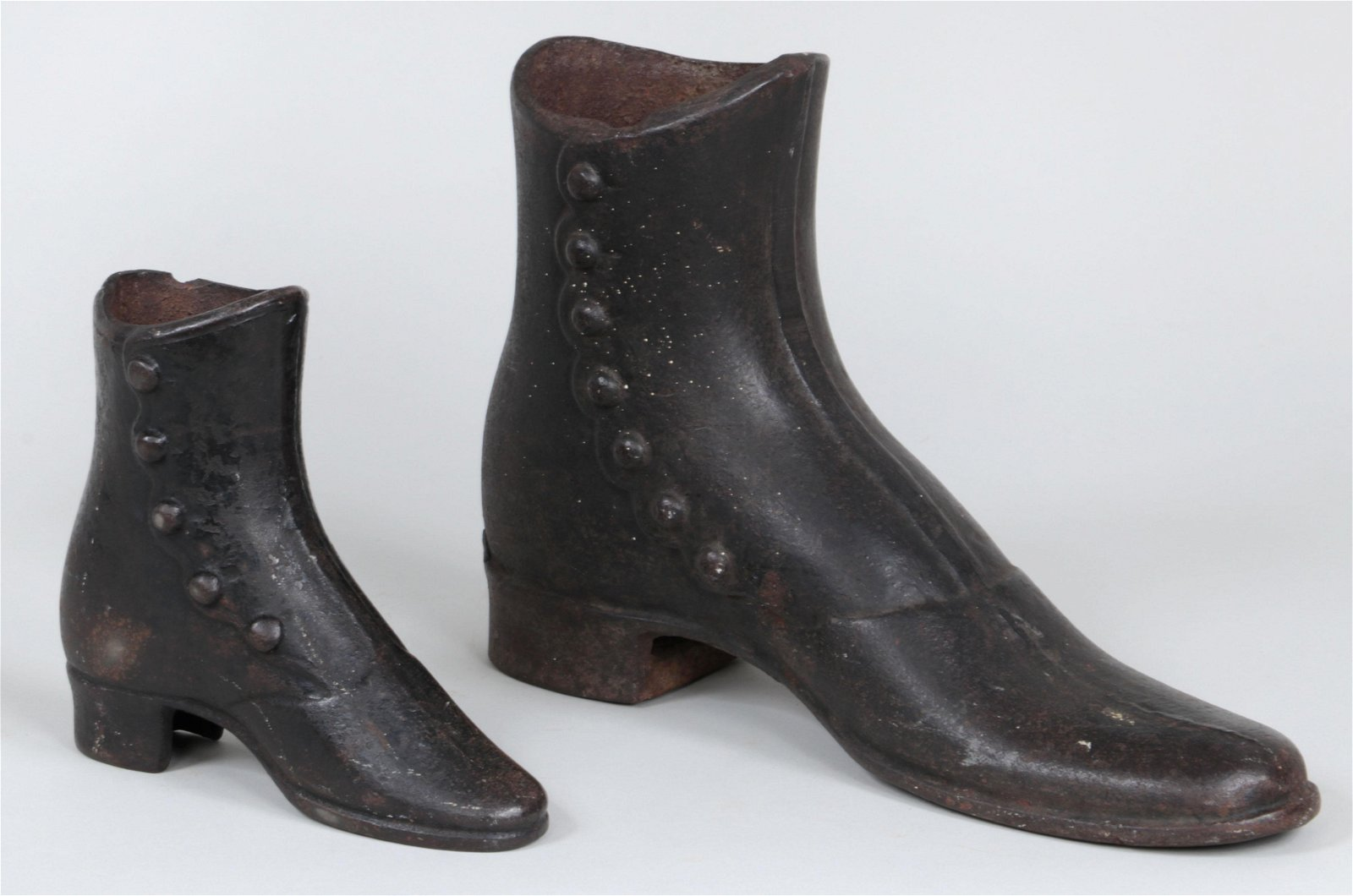 Group of (2) Victorian cast iron boots