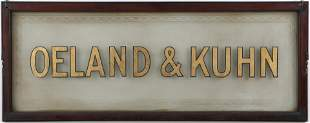 Etched glass and gilt lettered sign