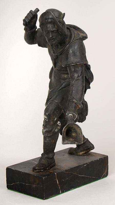 White metal statue of a poacher