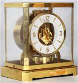 Swiss LeCoultre Atmos brass and glass cased clock with