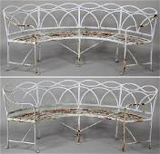 Pair of large curved wrought iron garden benches with