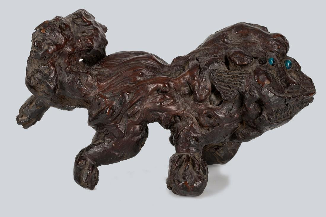 A Rootwood Lion Form Paperweight, Qing Dynasty. - 2