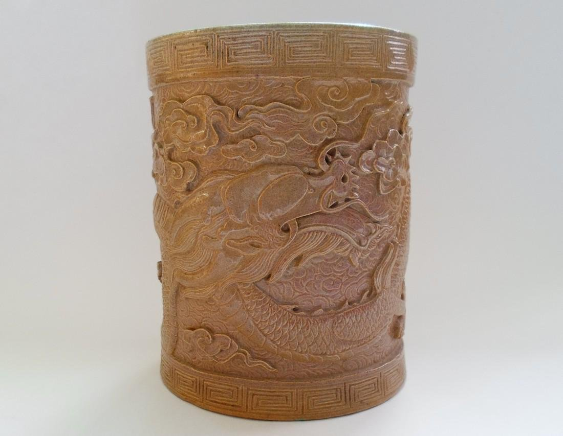 A Chinese Glazed Pottery Brush Pot Decorated With a