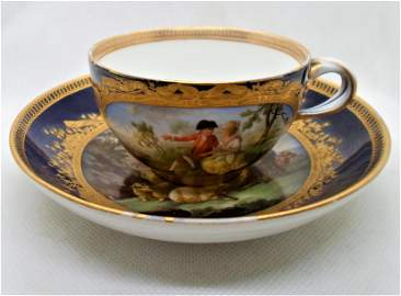 A Rare Meissen floral monogrammed cup and saucer,