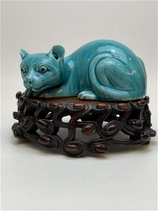 A Chinese Porcelain Cat Figure on Wooden Stand
