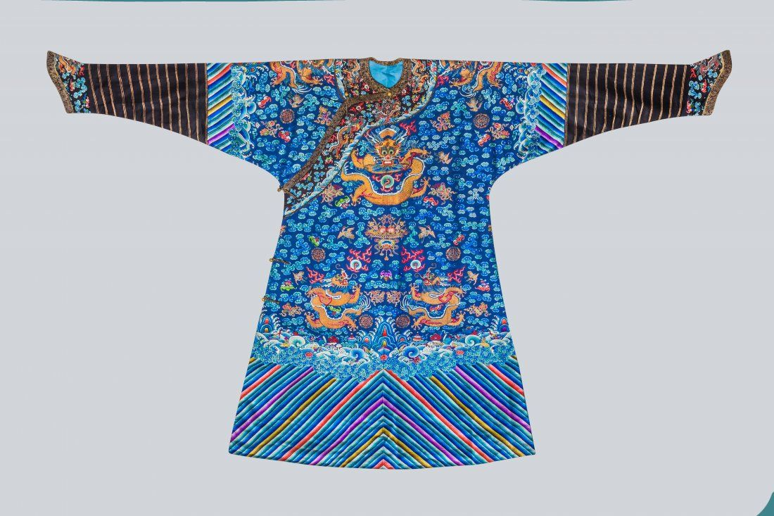 An Embroidered Blue Silk Dragons Robe, China, Qing
