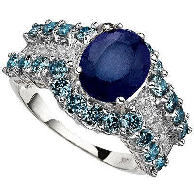 OVAL CREATED SAPPHIRE RING SET IN 14K WHITE GOLD
