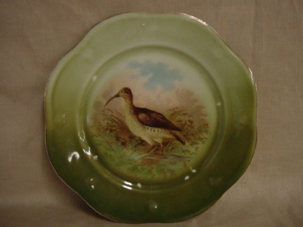 8013: Hand painted bird game plate
