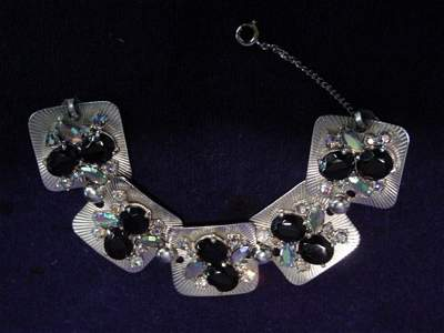 8127: Shiaparelli bracelet with black and clear stones