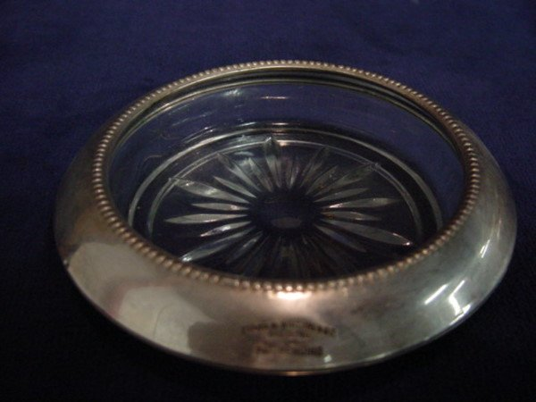 6110: Whiting & Co. sterling trim coasters