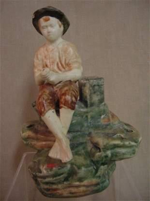 Boy fishing figurine, possibly Weller