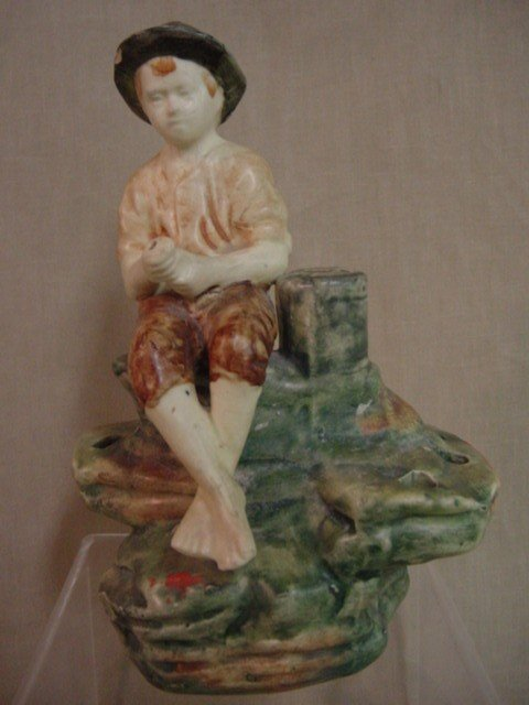 118: Boy fishing figurine, possibly Weller