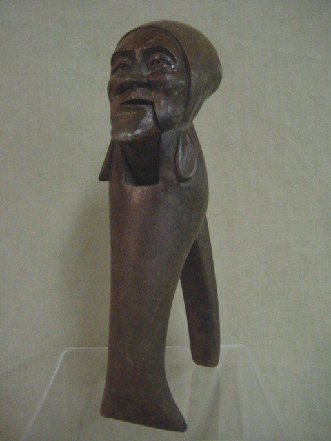 Hand carved lady head nut cracker