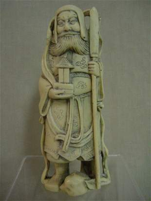 Ivory or bone asian statue highly carved