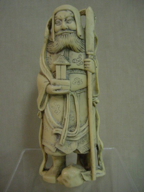 122: Ivory or bone asian statue highly carved