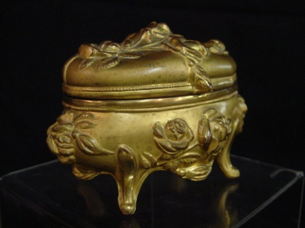242: Gold color metal jewelry box